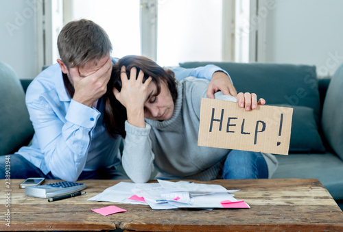 Fotomural  Young Couple having financial problems feeling stressed paying bills debts mortg