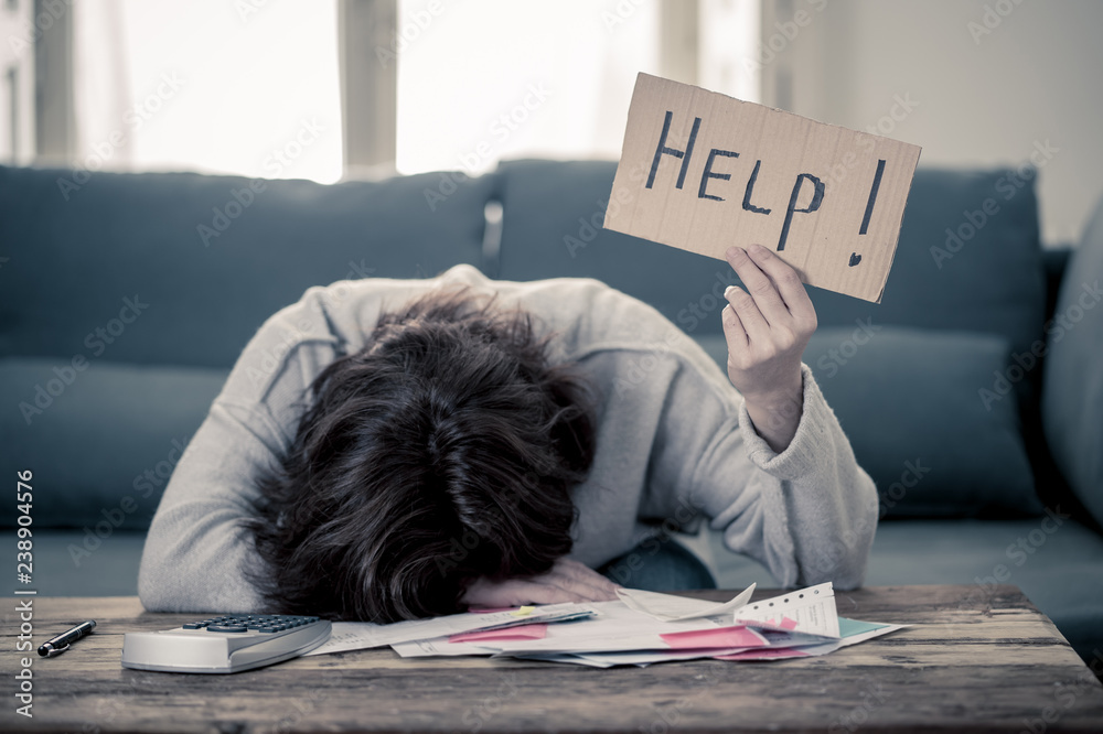 Fototapeta Upset young woman asking for help in paying bills Mortgage home or business finance problems