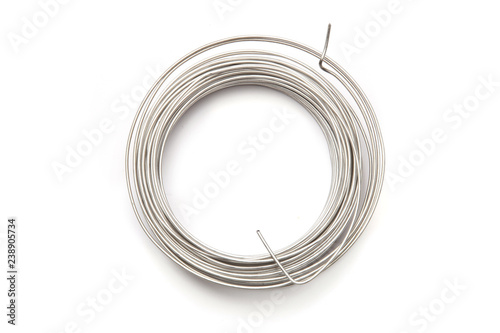 Coil of stainless steel wire isolated on white background Fotobehang