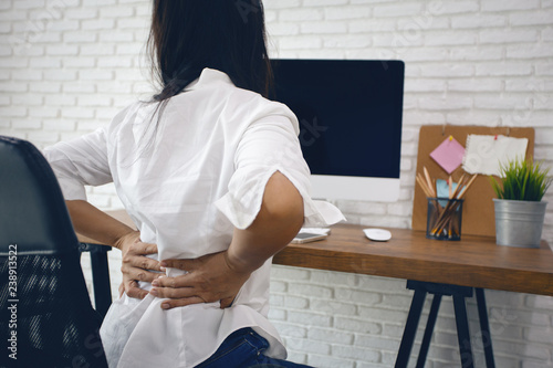 Fotografía  Business woman suffering from back pain in office home