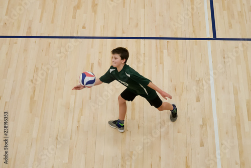 Volleyball player passes ball with one hand