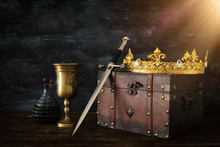 Low Key Image Of Beautiful Queen/king Crown, Wine Cup And Sword. Fantasy Medieval Period.