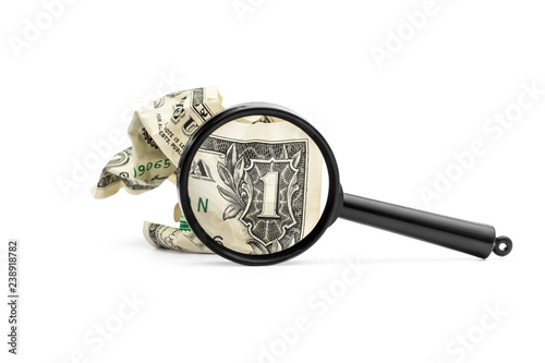 Crumpled one dollar bill with magnifying glass on white. Wallpaper Mural