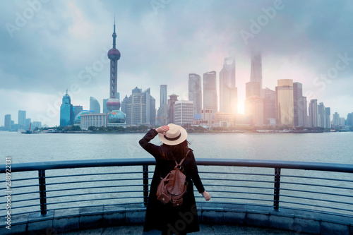 Foto auf Leinwand Shanghai Woman tourist is enjoy watching landmark view city skyline business district in Shanghai, China.