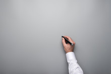 Male Hand About To Write On Grey Background