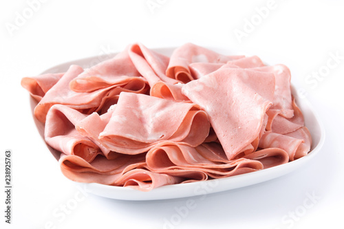 Mortadella slices on white plate isolated on white background. Close up