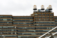 Close-up View Of New York's Buildings With Water Tanks On The Rooftop. Manhattan, New York City, USA.