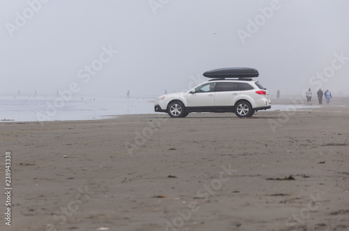 Fotografie, Obraz  A white SUV in Pacific beach area, Ocean Shores, WA