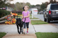 Young Girl Walking Her Dog