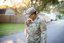 Soldier Holding His Dog