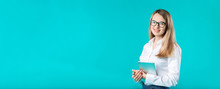 Portrait Young Caucasian Woman Worker Teacher Trainer Mentoring In White Shirt Office Style Long Hair With A Tablet In Hand Uses Technology Isolated Bright Color Blue Background.
