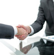 close up. business people handshake over the Desk