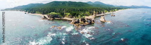 Staande foto Bleke violet Aerial drone photo of cape Ptichiy (near by cape Velikan), Sakhalin island, Russia (Sahalin). Surrealistic landscape of natural arches created by wind and sea erosion.