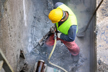 Worker Demolish Old Concrete W...