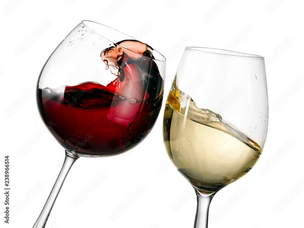 Red and white wine glasses plash, close up