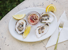 Oysters With Mignonette Sauce And Lemon