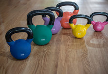 Colorful Kettlebells In A Row On Floor In A Gym, Orange, Green, Violet, Blue, Yellow, Pink,