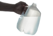 Hand Holding 1 Gallon Plastic Bottle Of Drinking Water; Silhouette On White.