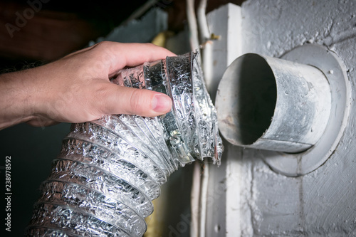 Fotografía Flexible aluminum dryer vent hose, removed for cleaning/repair/maintenance