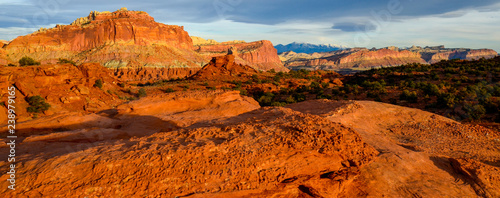Spoed Foto op Canvas Baksteen Sunset during golden hour in Southern Utah, sun warming red sandstone, cliffs, mountains, and mesa