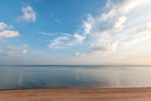 Bright Beautiful Seascape, Sandy Beach, Clouds Reflected In The Water, Natural Minimalistic Background And Texture