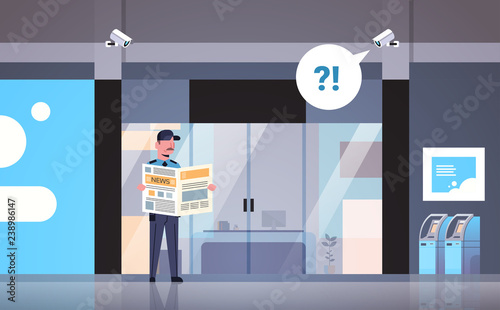 security guard man reading newspaper distracted at workplace entrance door busin Canvas Print