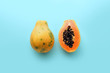 canvas print picture - Hawaii papaya on a pastel blue background, creative food concept, tropical fruit flat lay
