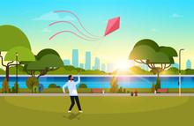 Young Man Launching Kite Outdo...