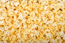 Top View Flat Lay Background Of Popped Popcorn.