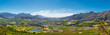canvas print picture - Franschhoek valley panorama with its famous wineries and surrounding mountains, South Africa