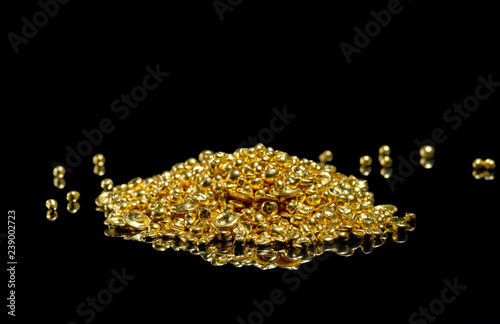 Fotografia, Obraz  A bunch of gold grains. Isolated on a black background.