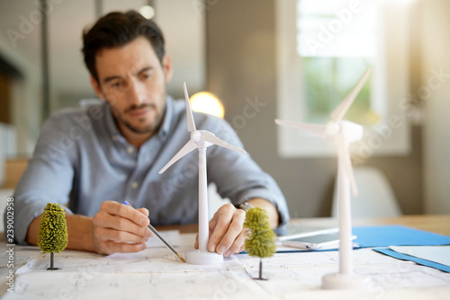 Handsome wind turbine engineer working in modern office