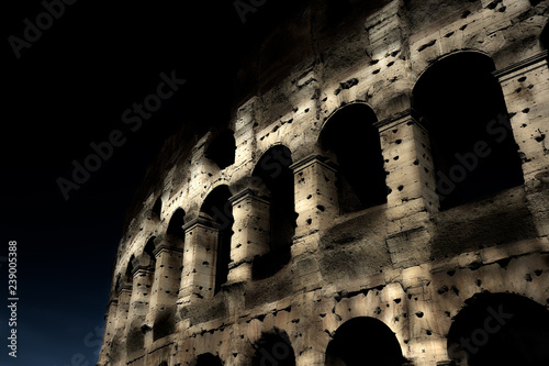 Fotografie, Obraz  A section of the facade of the Colosseum (Flavian Amphitheatre) in Rome during the blue hour