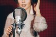 Leinwandbild Motiv close up photo. talented female near the microphone. blurred background. tool, instrument, device