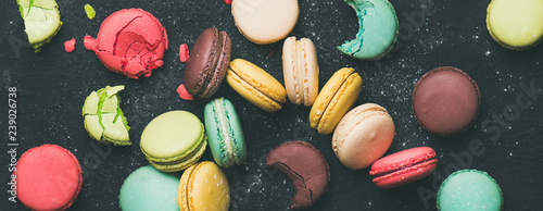 Fotobehang Macarons Flat-lay of sweet colorful French macaroon cookies variety, wide composition