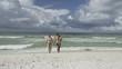Happy family enjoying morning walk on the beach 4k