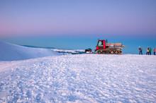 Snowcat On A Mountain At Sunri...
