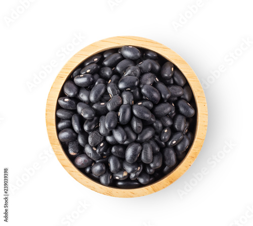 Fototapeta black beans in wood bowl isolated on white background. top view obraz