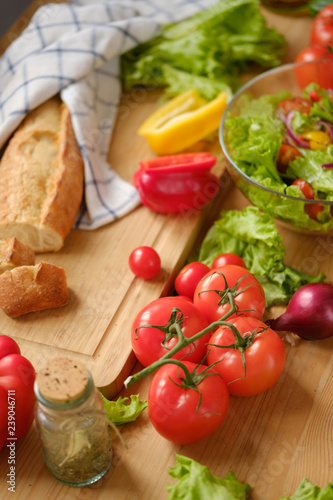 Various fresh vegetables and farm bread on a wooden table. Autumn harvest and healthy natural food concept.