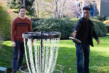 Men Playing Disc Golf