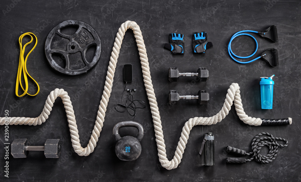 Fototapety, obrazy: Sports equipment on a black background. Top view. Motivation