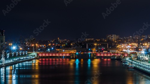 Photo Stands New York CITY AT NIGHT - Ship on the river, boulevards and landscape of Szczecin in the night illumination