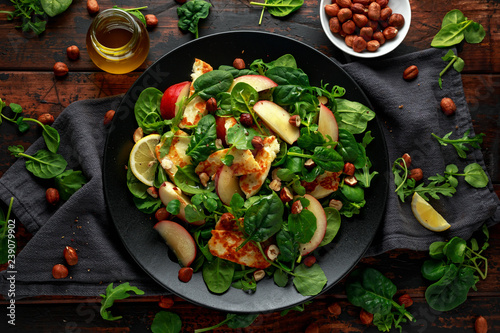 Garden Poster Cyprus Grilled Halloumi Cheese salad with peach fruit, nuts and spinach, arugula mix. healthy food