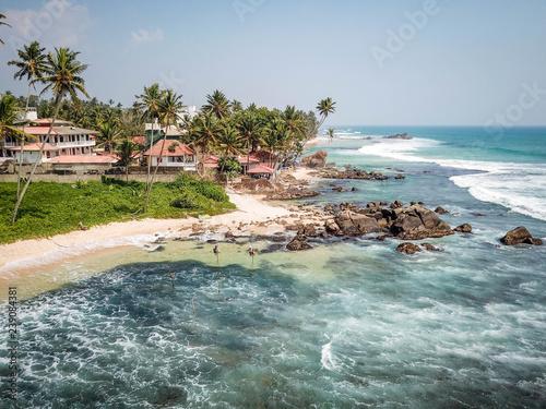 Aluminium Prints Beach Sri Lanka traditional fisherman in Dalawella Beach, aerial view