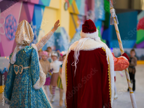 Garden Poster Fairytale World Saint-Petersburg, Russia december 17 . 2017: children's figure skate performance in the New Year eve with Santa Claus and Snow Maiden