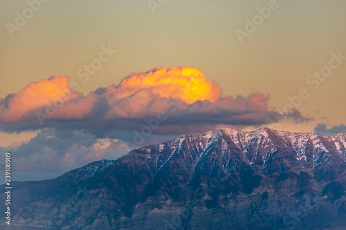 Fotografie, Obraz  Clouds are lit up by sunset over Timpanogos