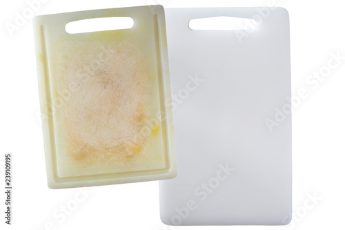 New clean and dirty white plastic cutting board with dark stains scratch isolated on white.