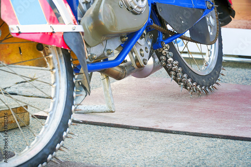 Fotografiet  Motorcycle spiked wheels for speedway
