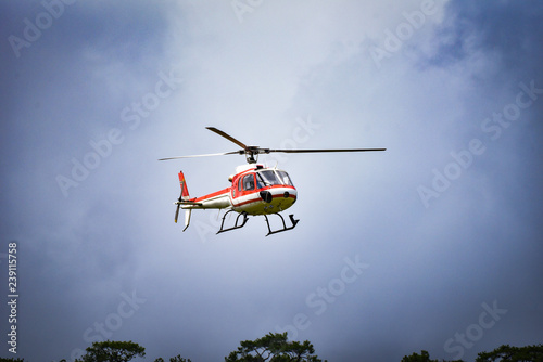 Staande foto helicopter rescue flying on sky white red fly helicopter storm
