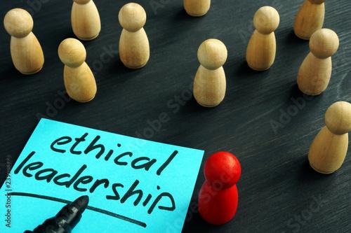Fotografie, Obraz  Ethical leadership. Wooden figures on a desk.